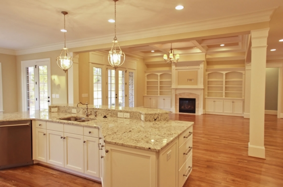 Custom kitchen with marble countertops, coffered ceiling and built-ins by MarDon Construction