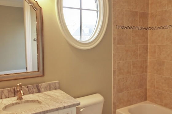 Full bath with custom tile and marble countertops by MarDon Construction