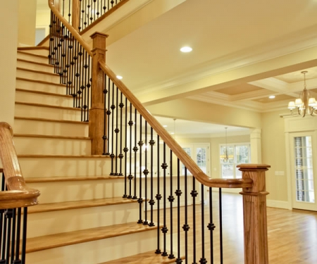 Custom staircase with iron accents and custom wood accents by MarDon Construction