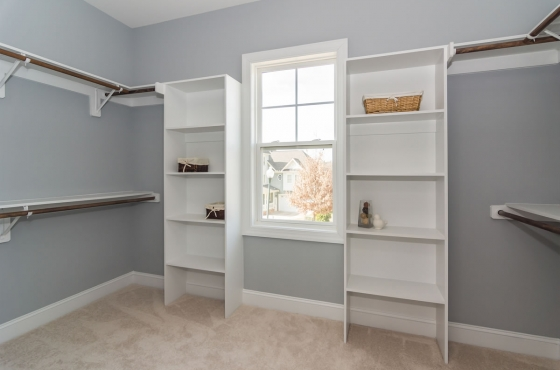 Custom built-ins in a master closet by MarDon Construction