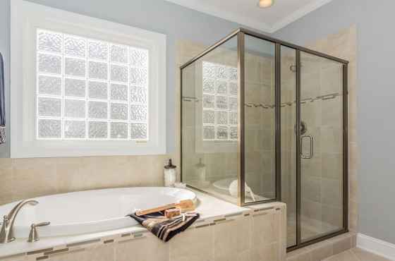 Master bath with walk-in shower and tub by MarDon Construction